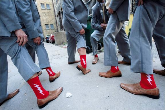 groomsmen-wear-grey-suits-brown-shoes-red-sock it to me -socks