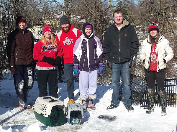 Sock It to Me Cool Girl Tracy Wiczer with a group of volunteers rescuing rabbits in the snow.