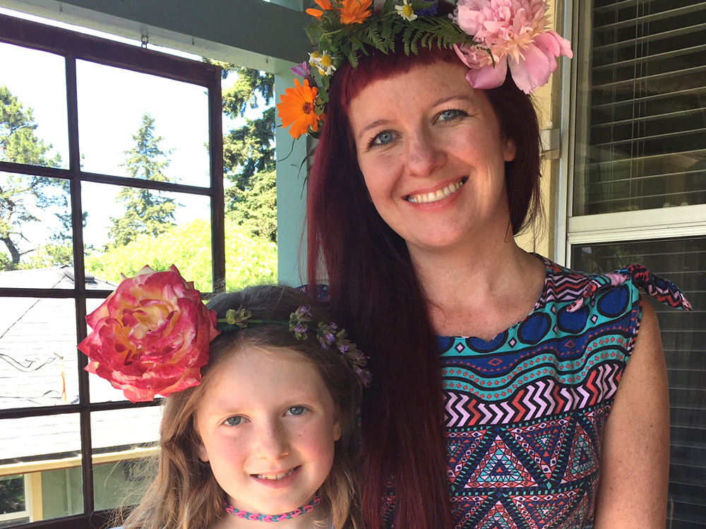 Sock It to Me Cool Girl Julz Nally with Daughter Juniper, both in flower crowns as featured image.