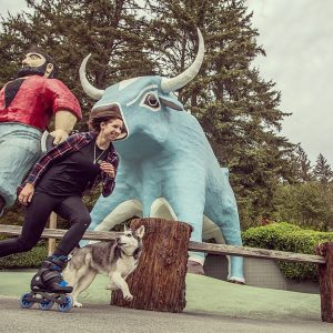 Megan and Canon racing by Paul Bunyan and Babe the Blue Ox.