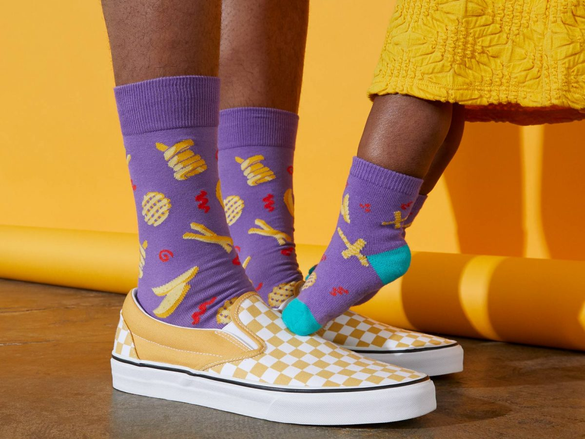 father and daughter wearing socks that show off their love of french fries